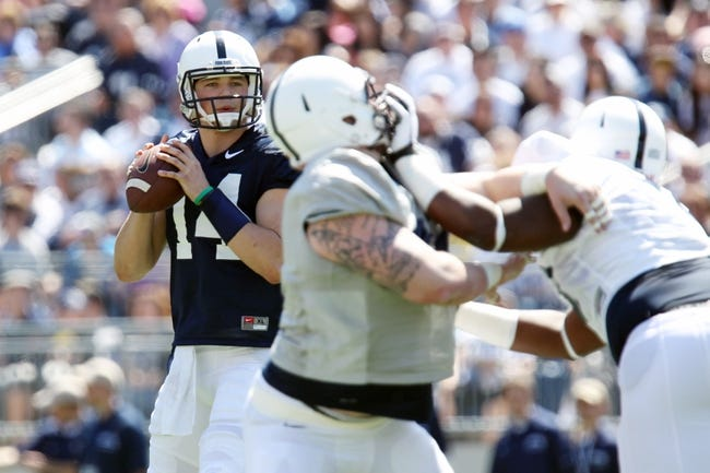 Apr 12, 2014; State College, PA, USA; Penn State Nittany Lions quarterback Christian Hackenberg (14) drops back in the pocket in the first quarter of the Blue White spring game at Beaver Stadium. The Blue team defeated the White team 37-0. Mandatory Credit: Matthew O'Haren-USA TODAY Sports