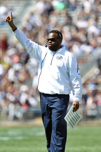Apr 12, 2014; State College, PA, USA; Penn State Nittany Lions special teams coordinator/running backs coach Charles Huff signals from the sideline in the second quarter of the Blue White spring game at Beaver Stadium. The Blue team defeated the White team 37-0. Mandatory Credit: Matthew O'Haren-USA TODAY Sports