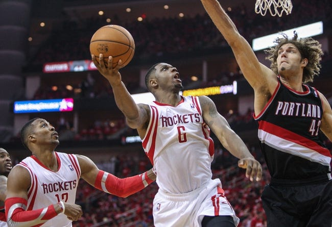 Apr 20, 2014; Houston, TX, USA; Houston Rockets forward Terrence Jones (6) attempts a shot during the third quarter as Portland Trail Blazers center Robin Lopez (42) defends in game one during the first round of the 2014 NBA Playoffs at Toyota Center. Mandatory Credit: Troy Taormina-USA TODAY Sports