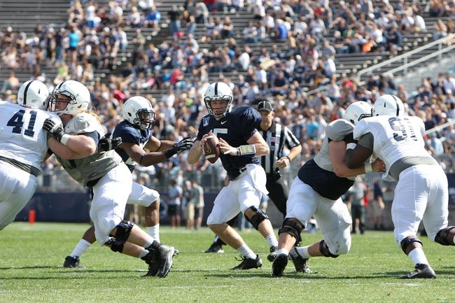 Apr 12, 2014; State College, PA, USA; Penn State Nittany Lions quarterback Michael O'Connor (15) drops back in the pocket in the fourth quarter of the Blue White spring game at Beaver Stadium. The Blue team defeated the White team 37-0. Mandatory Credit: Matthew O'Haren-USA TODAY Sports