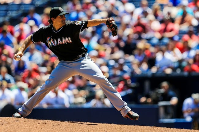 Apr 23, 2014; Atlanta, GA, USA; Miami Marlins starting pitcher Nate Eovaldi (24) pitches in the second inning against the Atlanta Braves at Turner Field. Mandatory Credit: Daniel Shirey-USA TODAY Sports