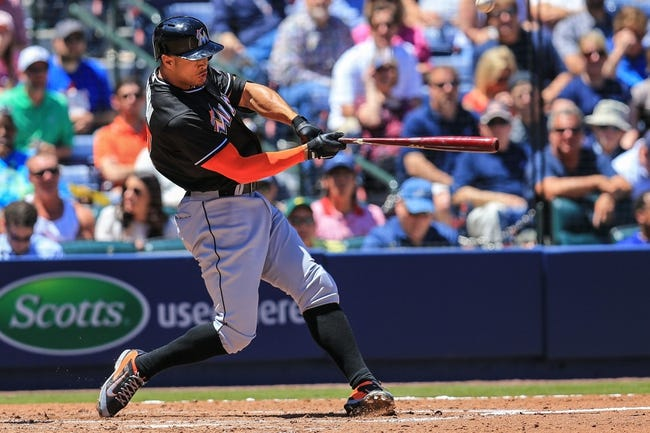 Apr 23, 2014; Atlanta, GA, USA; Miami Marlins right fielder Giancarlo Stanton (27) hits an RBI double in the sixth inning against the Atlanta Braves at Turner Field. Mandatory Credit: Daniel Shirey-USA TODAY Sports