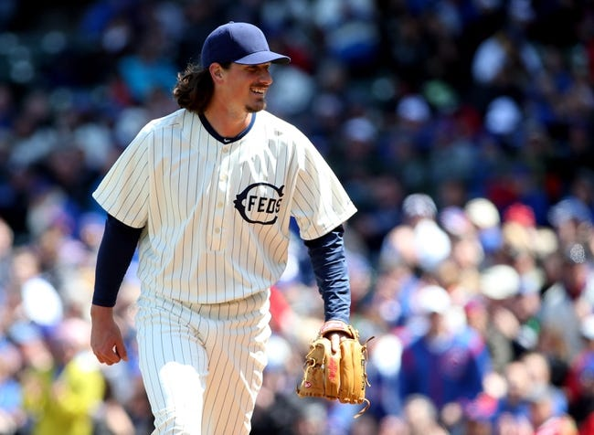 Apr 23, 2014; Chicago, IL, USA; Chicago Cubs starting pitcher Jeff Samardzija walks back to the dugout during the first inning of a baseball game against the Arizona Diamondbacks at Wrigley Field. Mandatory Credit: Jerry Lai-USA TODAY Sports