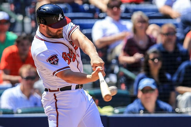 Apr 23, 2014; Atlanta, GA, USA; Atlanta Braves catcher Evan Gattis (24) hits a two-RBI double in the eighth inning against the Miami Marlins at Turner Field. Mandatory Credit: Daniel Shirey-USA TODAY Sports