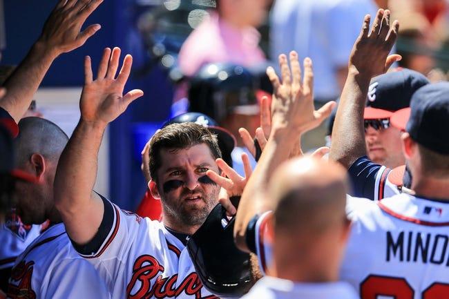 Apr 23, 2014; Atlanta, GA, USA; Atlanta Braves second baseman Dan Uggla (26) celebrates after scoring in the eighth inning against the Miami Marlins at Turner Field. Mandatory Credit: Daniel Shirey-USA TODAY Sports