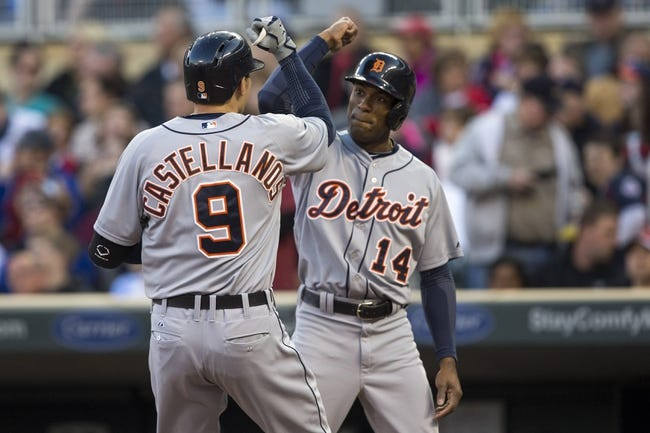 Apr 25, 2014; Minneapolis, MN, USA; Detroit Tigers third baseman Nick Castellanos (9) celebrates with center fielder Austin Jackson (14) after hitting a home run in the second inning against the Minnesota Twins at Target Field. Mandatory Credit: Jesse Johnson-USA TODAY Sports