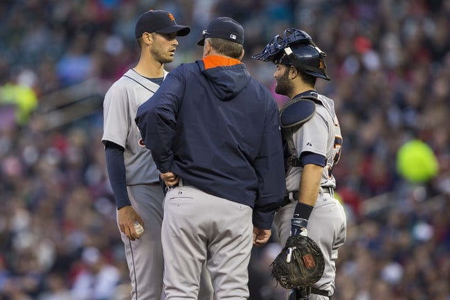 Apr 25, 2014; Minneapolis, MN, USA; Detroit Tigers pitching coach Jeff Jones talks to starting pitcher Rick Porcello (21) and catcher Alex Avila (13) in the second inning against the Minnesota Twins at Target Field. Mandatory Credit: Jesse Johnson-USA TODAY Sports