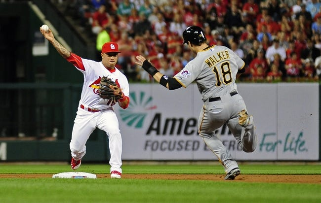 Apr 25, 2014; St. Louis, MO, USA; St. Louis Cardinals second baseman Kolten Wong (16) turns a double play as Pittsburgh Pirates second baseman Neil Walker (18) slides during the third inning at Busch Stadium. Mandatory Credit: Jeff Curry-USA TODAY Sports