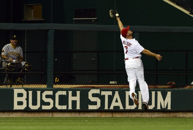 Apr 25, 2014; St. Louis, MO, USA; St. Louis Cardinals left fielder Matt Holliday (7) is unable to catch a ball hit by Pittsburgh Pirates center fielder Andrew McCutchen (not pictured) during the sixth inning at Busch Stadium. Mandatory Credit: Jeff Curry-USA TODAY Sports