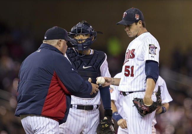 Apr 25, 2014; Minneapolis, MN, USA; Minnesota Twins relief pitcher Anthony Swarzak (51) gets pulled from the game by Minnesota Twins manager Ron Gardenhire in the sixth inning against the sixth inning at Target Field. Mandatory Credit: Jesse Johnson-USA TODAY Sports