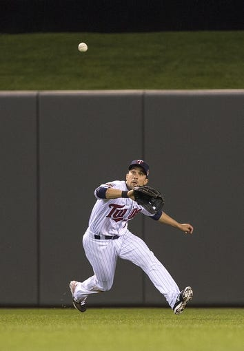 Apr 25, 2014; Minneapolis, MN, USA; Minnesota Twins center fielder Sam Fuld (1) catches a fly ball in the sixth inning against the Detroit Tigers at Target Field. Mandatory Credit: Jesse Johnson-USA TODAY Sports