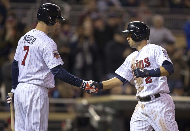 Apr 25, 2014; Minneapolis, MN, USA; Minnesota Twins second baseman Brian Dozier (2) shakes hands with first baseman Joe Mauer (7) after hitting a home run in the sixth inning against the Detroit Tigers at Target Field. Mandatory Credit: Jesse Johnson-USA TODAY Sports