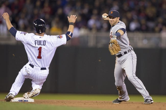 Apr 25, 2014; Minneapolis, MN, USA; Detroit Tigers shortstop Andrew Romine (27) forces out Minnesota Twins center fielder Sam Fuld (1) at second base and throws the ball to first base for a double play in the fifth inning at Target Field. Mandatory Credit: Jesse Johnson-USA TODAY Sports