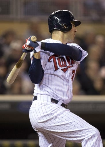 Apr 25, 2014; Minneapolis, MN, USA; Minnesota Twins first baseman Joe Mauer (7) hits a single in the sixth inning against the Detroit Tigers at Target Field. Mandatory Credit: Jesse Johnson-USA TODAY Sports