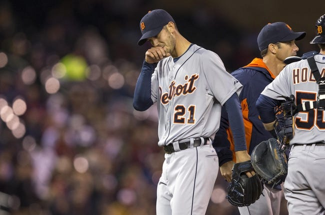 Apr 25, 2014; Minneapolis, MN, USA; Detroit Tigers starting pitcher Rick Porcello (21) gets pulled from the game in the sixth inning against the Minnesota Twins at Target Field. Mandatory Credit: Jesse Johnson-USA TODAY Sports