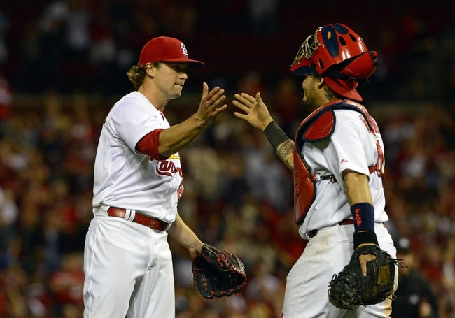 Apr 25, 2014; St. Louis, MO, USA; St. Louis Cardinals relief pitcher Trevor Rosenthal (26) celebrates with catcher Yadier Molina (4) after defeating the Pittsburgh Pirates 1-0 at Busch Stadium. Mandatory Credit: Jeff Curry-USA TODAY Sports