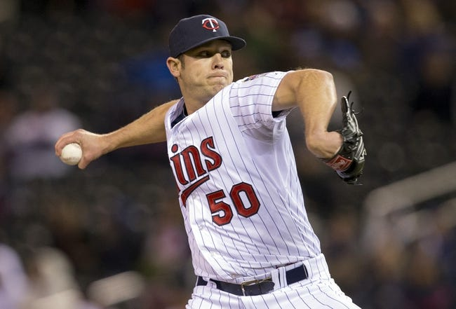 Apr 25, 2014; Minneapolis, MN, USA; Minnesota Twins relief pitcher Casey Fien (50) delivers a pitch in the ninth inning against the Detroit Tigers at Target Field. The Tigers won 10-6. Mandatory Credit: Jesse Johnson-USA TODAY Sports