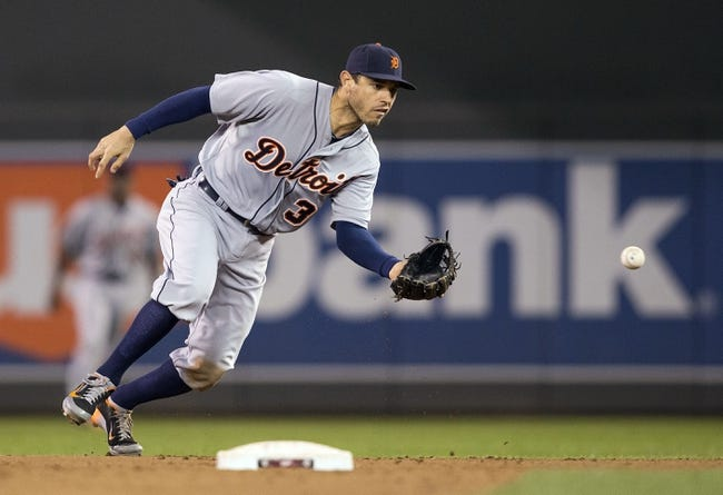 Apr 25, 2014; Minneapolis, MN, USA; Detroit Tigers second baseman Ian Kinsler (3) fields a ground ball in the ninth inning against the Minnesota Twins at Target Field. The Tigers won 10-6. Mandatory Credit: Jesse Johnson-USA TODAY Sports