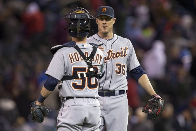 Apr 25, 2014; Minneapolis, MN, USA; Detroit Tigers relief pitcher Joe Nathan (36) and catcher Bryan Holaday (50) celebrate after beating the Minnesota Twins at Target Field. The Tigers won 10-6. Mandatory Credit: Jesse Johnson-USA TODAY Sports
