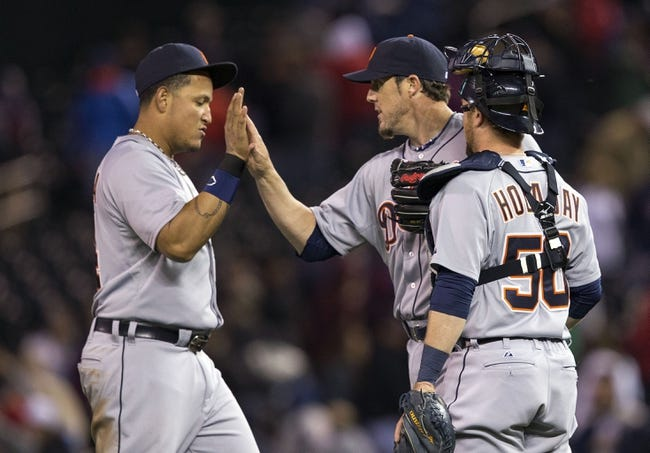 Apr 25, 2014; Minneapolis, MN, USA; Detroit Tigers first baseman Miguel Cabrera (24), relief pitcher Joe Nathan (36) and catcher Bryan Holaday (50) celebrate after beating the Minnesota Twins at Target Field. The Tigers won 10-6. Mandatory Credit: Jesse Johnson-USA TODAY Sports