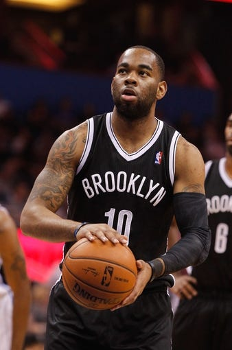 Apr 9, 2014; Orlando, FL, USA; Brooklyn Nets guard Marcus Thornton (10) shoots a free throw against the Orlando Magic during the first quarter at Amway Center. Mandatory Credit: Kim Klement-USA TODAY Sports