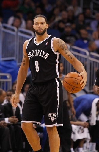 Apr 9, 2014; Orlando, FL, USA; Brooklyn Nets guard Deron Williams (8)  dribbles the ball against the Orlando Magic during the second quarter at Amway Center. Mandatory Credit: Kim Klement-USA TODAY Sports