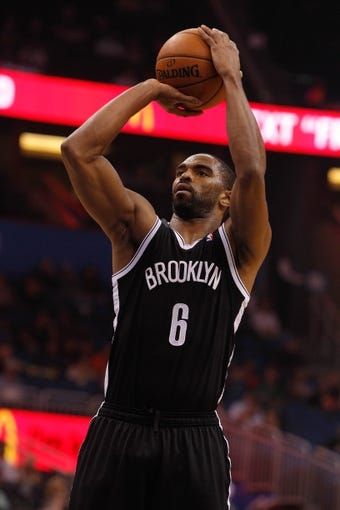 Apr 9, 2014; Orlando, FL, USA; Brooklyn Nets forward Alan Anderson (6) shoots a free throw against the Orlando Magic during the first quarter at Amway Center. Mandatory Credit: Kim Klement-USA TODAY Sports