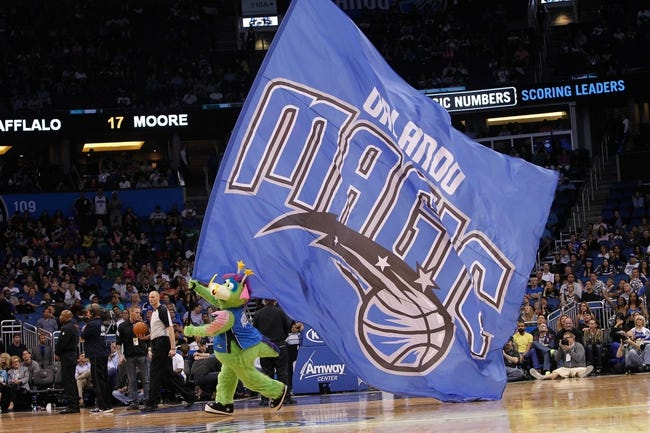 Apr 9, 2014; Orlando, FL, USA; Orlando Magic mascot, Stuff, holds a big flag against the Brooklyn Nets during the second half at Amway Center. Orlando Magic defeated the Brooklyn Nets 115-111. Mandatory Credit: Kim Klement-USA TODAY Sports
