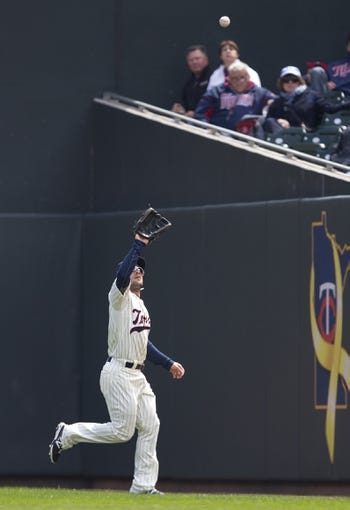 Apr 26, 2014; Minneapolis, MN, USA; Minnesota Twins right fielder Sam Fuld (1) catches a fly ball in the first inning against the Detroit Tigers at Target Field. Mandatory Credit: Jesse Johnson-USA TODAY Sports