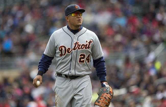 Apr 26, 2014; Minneapolis, MN, USA; Detroit Tigers first baseman Miguel Cabrera (24) looks on during the fifth inning against the Minnesota Twins at Target Field. Mandatory Credit: Jesse Johnson-USA TODAY Sports