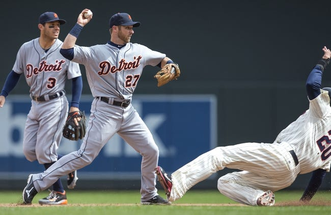 Apr 26, 2014; Minneapolis, MN, USA; Detroit Tigers shortstop Andrew Romine (27) forces out Minnesota Twins first baseman Chris Colabello (20) at second base and throws the ball to first base for a double play in the fifth inning at Target Field. Mandatory Credit: Jesse Johnson-USA TODAY Sports