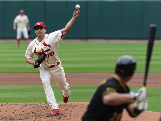 Apr 26, 2014; St. Louis, MO, USA; St. Louis Cardinals starting pitcher Tyler Lyons (70) throws to Pittsburgh Pirates catcher Tony Sanchez (26) during the third inning at Busch Stadium. Mandatory Credit: Jeff Curry-USA TODAY Sports
