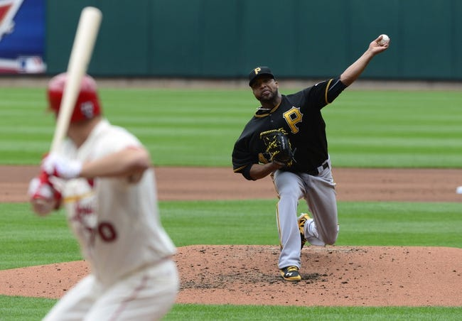 Apr 26, 2014; St. Louis, MO, USA; Pittsburgh Pirates starting pitcher Francisco Liriano (47) throws to St. Louis Cardinals starting pitcher Tyler Lyons (70) during the third inning at Busch Stadium. Mandatory Credit: Jeff Curry-USA TODAY Sports