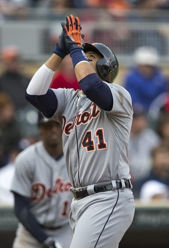 Apr 26, 2014; Minneapolis, MN, USA; Detroit Tigers designated hitter Victor Martinez (41) celebrates after hitting a home run in the ninth inning against the Minnesota Twins at Target Field. The Twins won 5-3. Mandatory Credit: Jesse Johnson-USA TODAY Sports