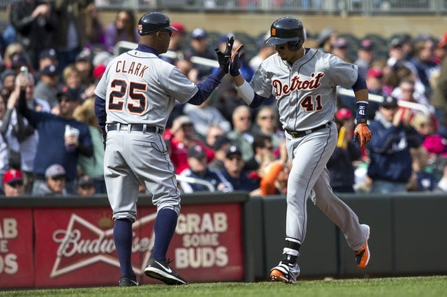 Apr 26, 2014; Minneapolis, MN, USA; Detroit Tigers designated hitter Victor Martinez (41) celebrates with third base coach Dave Clark (25) after hitting a home run in the ninth inning against the Minnesota Twins at Target Field. The Twins won 5-3. Mandatory Credit: Jesse Johnson-USA TODAY Sports