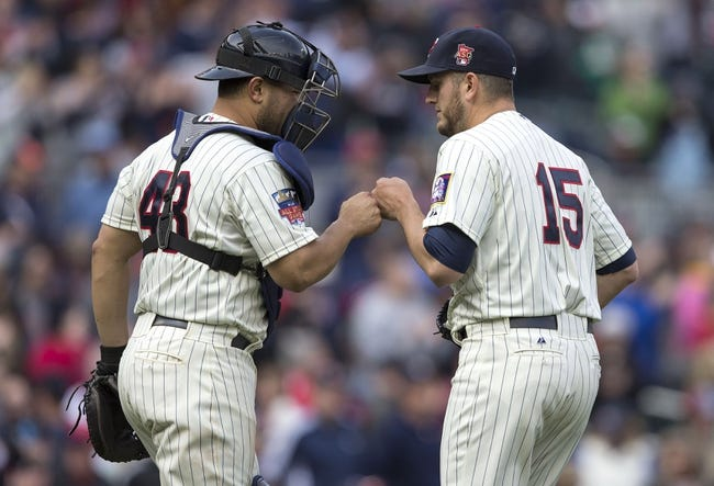 Apr 26, 2014; Minneapolis, MN, USA; Minnesota Twins catcher Josmil Pinto (43) celebrates with relief pitcher Glen Perkins (15) after beating the Detroit Tigers at Target Field. The Twins won 5-3. Mandatory Credit: Jesse Johnson-USA TODAY Sports