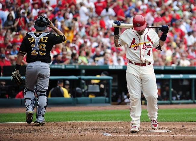 Apr 26, 2014; St. Louis, MO, USA; St. Louis Cardinals catcher Yadier Molina (4) walks back to the dugout after striking out with bases loaded against the Pittsburgh Pirates during the third inning at Busch Stadium. Mandatory Credit: Jeff Curry-USA TODAY Sports