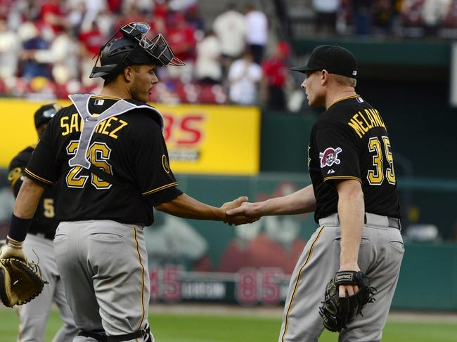 Apr 26, 2014; St. Louis, MO, USA; Pittsburgh Pirates relief pitcher Mark Melancon (35) is congratulated by catcher Tony Sanchez (26) after closing out the ninth inning against the St. Louis Cardinals at Busch Stadium. Pittsburgh defeated St. Louis 6-1. Mandatory Credit: Jeff Curry-USA TODAY Sports