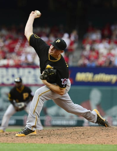 Apr 26, 2014; St. Louis, MO, USA; Pittsburgh Pirates relief pitcher Mark Melancon (35) throws to a St. Louis Cardinals batter during the ninth inning at Busch Stadium. Pittsburgh defeated St. Louis 6-1. Mandatory Credit: Jeff Curry-USA TODAY Sports