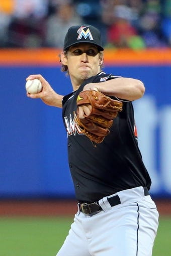 Apr 26, 2014; New York, NY, USA;  Miami Marlins starting pitcher Kevin Slowey (45) pitches during the first inning against the New York Mets at Citi Field. Mandatory Credit: Anthony Gruppuso-USA TODAY Sports