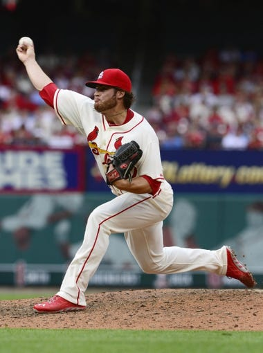 Apr 26, 2014; St. Louis, MO, USA; St. Louis Cardinals relief pitcher Eric Fornataro (67) throws to a Pittsburgh Pirates batter during the ninth inning at Busch Stadium. Pittsburgh defeated St. Louis 6-1. Mandatory Credit: Jeff Curry-USA TODAY Sports