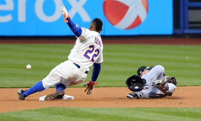 Apr 26, 2014; New York, NY, USA; New York Mets left fielder Eric Young Jr. (22) steals second base as Miami Marlins second baseman Derek Dietrich (32) misplays the ball during the first inning at Citi Field. Mandatory Credit: Anthony Gruppuso-USA TODAY Sports