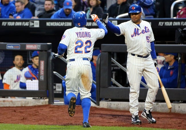 Apr 26, 2014; New York, NY, USA; New York Mets right fielder Bobby Abreu (53) high fives left fielder Eric Young Jr. (22) after Young scored a run during the first inning against the Miami Marlins at Citi Field. Mandatory Credit: Anthony Gruppuso-USA TODAY Sports