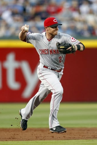 Apr 26, 2014; Atlanta, GA, USA; Cincinnati Reds shortstop Zack Cozart (2) throws a runner out at first against the Atlanta Braves in the first inning at Turner Field. Mandatory Credit: Brett Davis-USA TODAY Sports