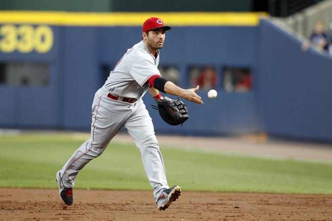 Apr 26, 2014; Atlanta, GA, USA; Cincinnati Reds first baseman Joey Votto (19) throws a runner out at first against the Atlanta Braves in the second inning at Turner Field. Mandatory Credit: Brett Davis-USA TODAY Sports