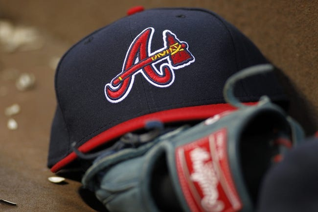 Apr 26, 2014; Atlanta, GA, USA; Detailed view of Atlanta Braves hat and glove in the dugout against the Cincinnati Reds in the third inning at Turner Field. Mandatory Credit: Brett Davis-USA TODAY Sports
