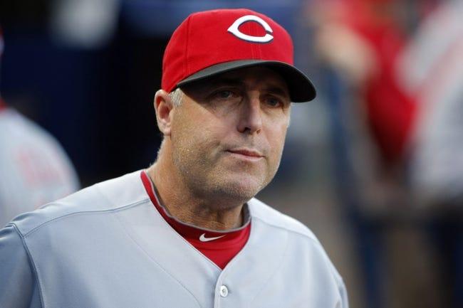 Apr 26, 2014; Atlanta, GA, USA; Cincinnati Reds manager Bryan Price (38) coaches against the Atlanta Braves in the second inning at Turner Field. Mandatory Credit: Brett Davis-USA TODAY Sports