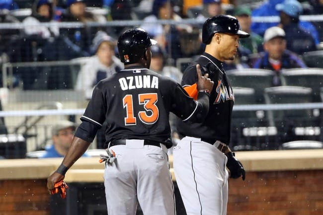 Apr 26, 2014; New York, NY, USA;  Miami Marlins player Giancarlo Stanton (right) celebrates with teammate Marcell Ozuna  after hitting a two-run home run during the sixth inning against the New York Mets at Citi Field. Mandatory Credit: Anthony Gruppuso-USA TODAY Sports