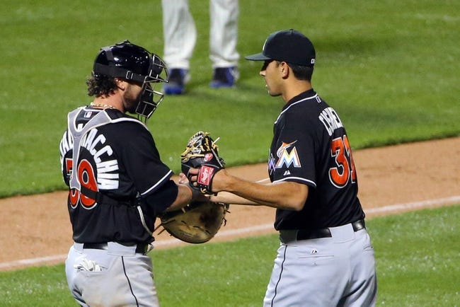 Apr 26, 2014; New York, NY, USA;  Miami Marlins relief pitcher Steve Cishek (31) and catcher Jarrod Saltalamacchia (39) celebrate the win against the New York Mets at Citi Field. Miami Marlins won 7-6 in ten innings. Mandatory Credit: Anthony Gruppuso-USA TODAY Sports