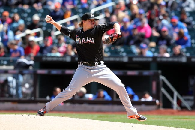 Apr 27, 2014; New York, NY, USA; Miami Marlins starting pitcher Tom Koehler (34) pitches against the New York Mets during the first inning of a game at Citi Field. Mandatory Credit: Brad Penner-USA TODAY Sports